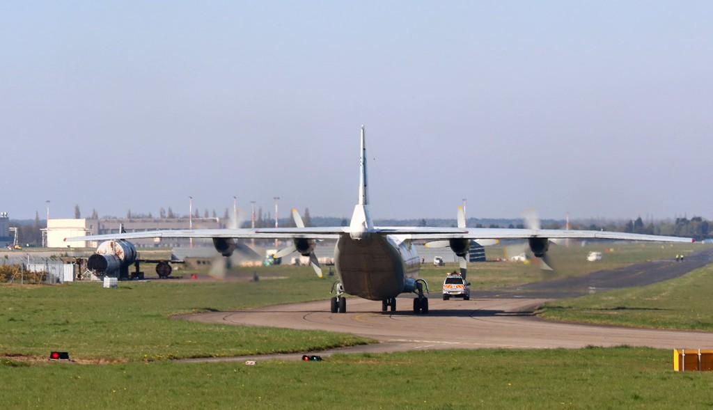 """Ukraine Air Alliance (UAA) Antonov An-12BK, UR-CAH  """"follows"""" to the Engine Test Bay<br /> By Correne Calow."""
