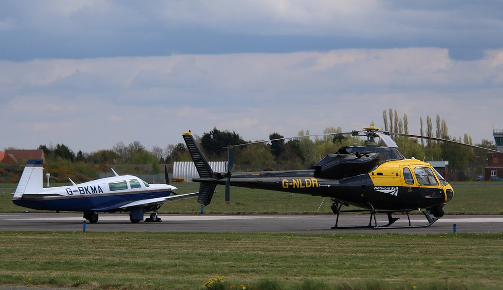 Mooney M20J, G-BKMA and PDG Helicopters, Ecureuil II AS355, G-NLDR<br /> By Correne Calow.