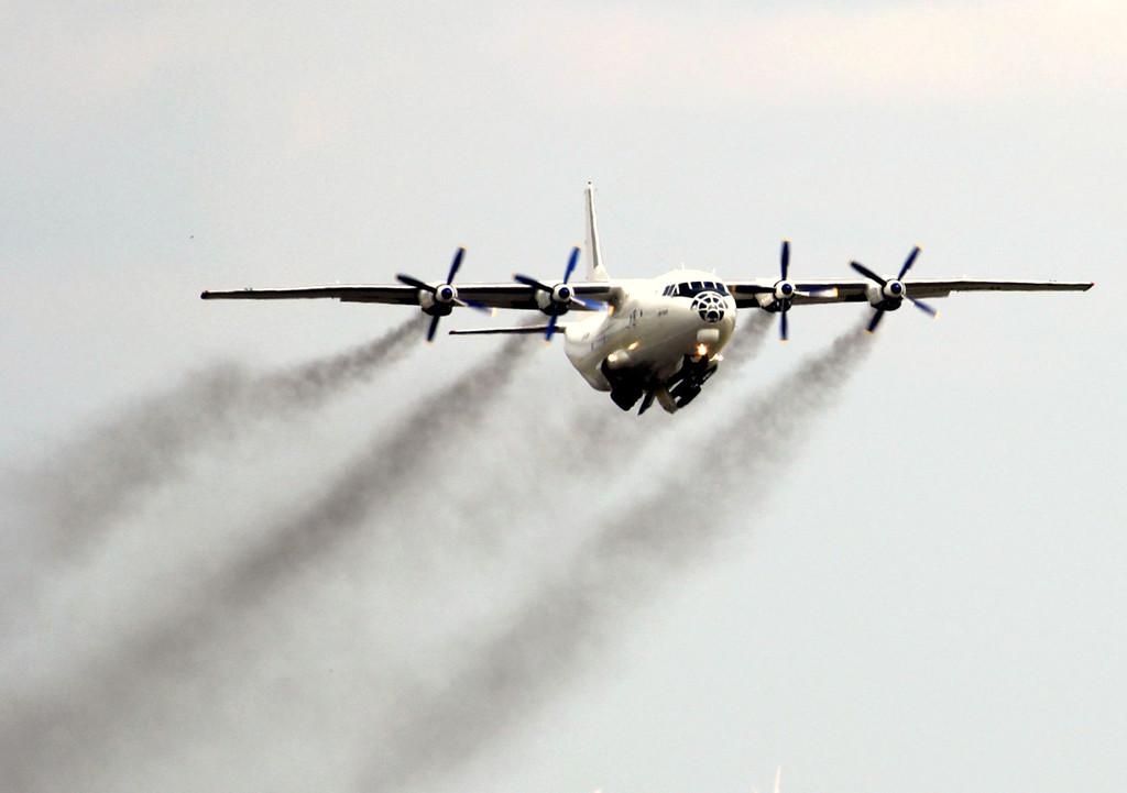 Cavok Airlines An-12BP UR-CKM.<br /> By Graham Vlacho.