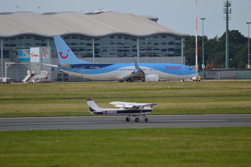 Thomson Airways 737-800 G-FDZA & Cessna 150 G-BMBB.<br /> By Kev Barwell.