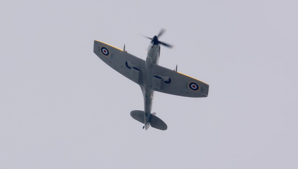 Passing over the field mid afternoon was BBMF Spitfire Mk XVI, TE311, en route to Lincoln & Conningsby.<br /> By Jim Calow.