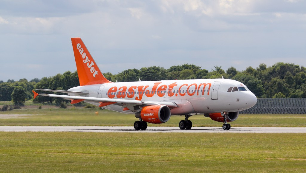 EasyJet A319 G-EZBX.<br /> By Jim Calow.