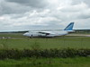 Antonov Airlines An-124, UR-82072 - rather than do a 180 degree turn around at the end of the runway, the aircraft mistakenly headed off on taxiway Alpha.  The pilot was told to stop and shut down engines.<br /> By Correne Calow.