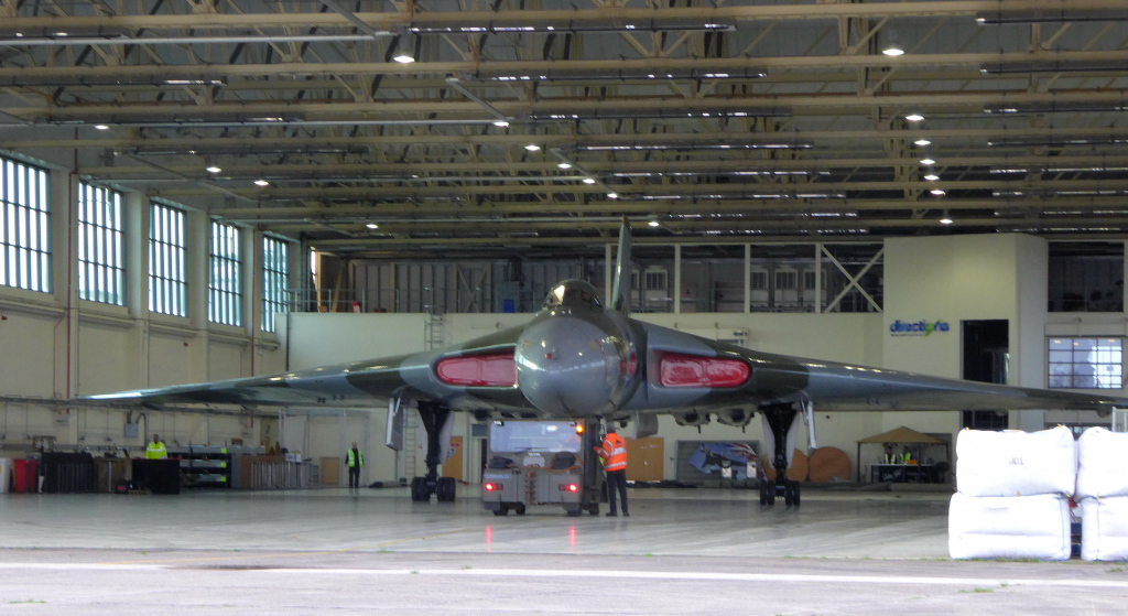 Vulcan XH558 is pushed back to the rear of the hangar.<br /> By Kev Barwell.