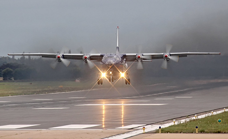 Ukraine Air Alliance An-12BK UR-CNT turns on the smoke for its departure to Malta.<br /> By Jim Calow.