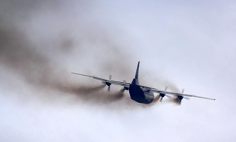 Ukraine Air Alliance An-12BK UR-CNT.<br /> By Jim Calow.