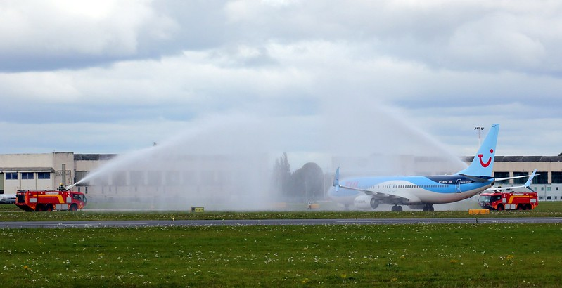 Thomson Airways, 737-800, G-TAWL  - water cannon salute to commemorate pilots last flight<br /> By Clive Featherstone.