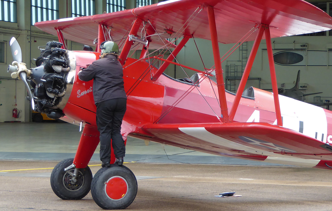 Sue Girdler of TG Aviation completes her pre-flight checks on G-BTFG<br /> By Correne Calow.