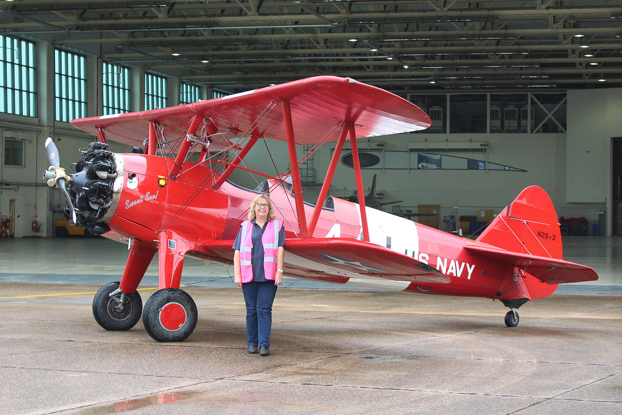 """Sue Girdler of TG Aviation was good enough to pose for a photo<br /> beside """"Sweet Sue"""" G-BTFG<br /> By Graham Miller."""