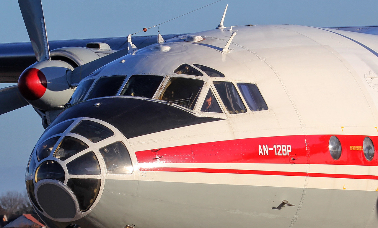 Ukraine Air Alliance, Antonov An-12BP, UR-CGW<br /> By Jim Calow.
