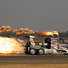 This truck is powered by a jet engine.  It races the planes on takeoff.
