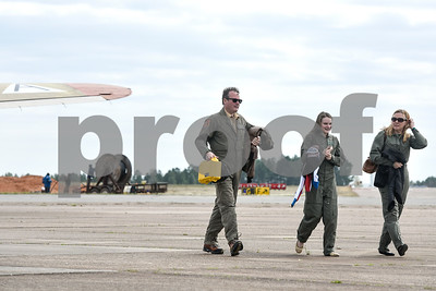 People walk on the tarmac after getting off the B-17 during the Wings of Freedom tour at the Tyler Pounds Regional Airport outside of the Historic Aviation Memorial Museum in Tyler, Texas, on Friday, March 9, 2018. The nationwide Wings of Freedom tour is celebrating its 29th year and visits an average of 110 cities in over 35 states annually.  (Chelsea Purgahn/Tyler Morning Telegraph)