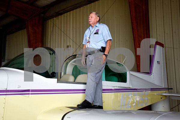 Louis Thomas, president of the Historical Aviation Memorial Museum, poses for a portrait with his plane at the Tyler Pounds Regional Airport in Tyler, Texas, on Tuesday, May 16, 2017. The HAMM staff works to preserve the history of aviation and will be sharing the knowledge during an aviation camp June 27 through July 1 for children 12 to 15 years old. (Chelsea Purgahn/Tyler Morning Telegraph)