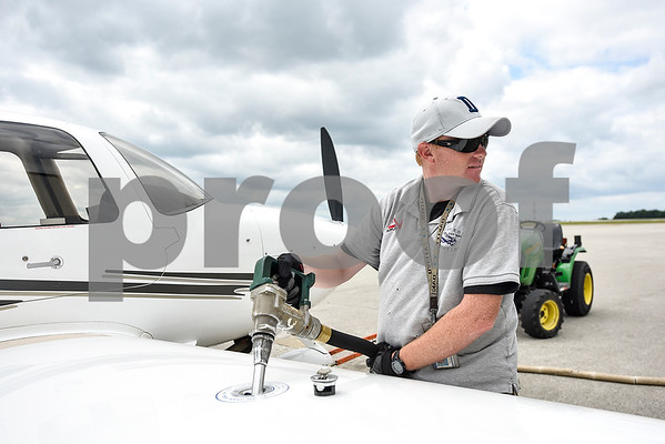 Brian Barnett pumps fuel into a plane at the Tyler Pounds Regional Airport in Tyler, Texas, on Tuesday, May 16, 2017. The Historical Aviation Memorial Museum at the airport works to preserve the history of aviation and will be sharing the knowledge during an aviation camp June 27 through July 1 for children 12 to 15 years old. (Chelsea Purgahn/Tyler Morning Telegraph)
