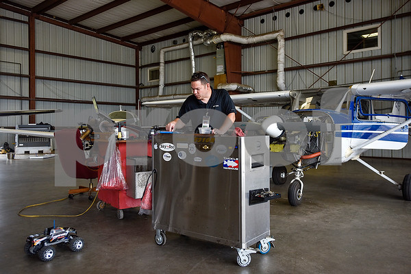 Aaron Smith works on planes at the Tyler Pounds Regional Airport in Tyler, Texas, on Tuesday, May 16, 2017. The Historical Aviation Memorial Museum at the airport works to preserve the history of aviation and will be sharing the knowledge during an aviation camp June 27 through July 1 for children 12 to 15 years old. (Chelsea Purgahn/Tyler Morning Telegraph)