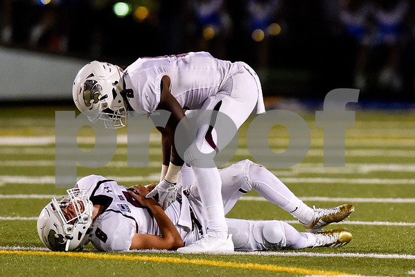 Whitehouse's Clayton Cook (8) checks on teammate Jacob Clemons (6) who lays on the ground as a penalty was called for roughing the punter during the 14th annual Christus Trinity Mother Frances Football Classic at Christus Trinity Mother Frances Rose Stadium in Tyler, Texas, on Thursday, Sept. 7, 2017. (Chelsea Purgahn/Tyler Morning Telegraph)