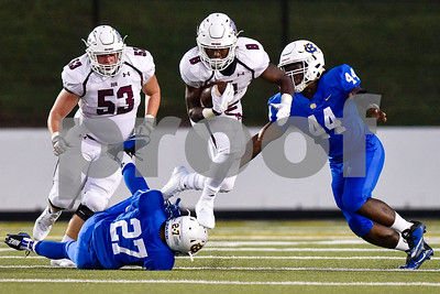 Whitehouse's Clayton Cook (8) jumps to avoid a tackle as he runs the ball during the 14th annual Christus Trinity Mother Frances Football Classic at Christus Trinity Mother Frances Rose Stadium in Tyler, Texas, on Thursday, Sept. 7, 2017. (Chelsea Purgahn/Tyler Morning Telegraph)