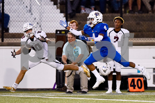 Whitehouse's Seth Dolan (10) and Chapel Hill's Billy Maddox (4) jump for a pass intended for Dolan during the 14th annual Christus Trinity Mother Frances Football Classic at Christus Trinity Mother Frances Rose Stadium in Tyler, Texas, on Thursday, Sept. 7, 2017. (Chelsea Purgahn/Tyler Morning Telegraph)