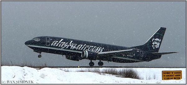 """FLYING BLIND"", Alaska airlines Boeing 737 taking off in a blizzard, Wrangell, Alaska, USA."
