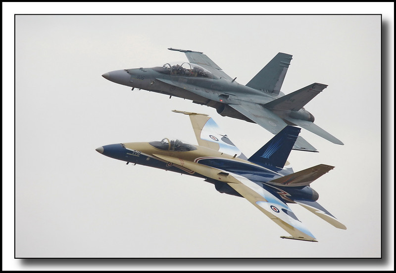 """Abbotsford Airshow 2009 - Canadian CF-18 Hornet's.  Bottom aircraft is painted in colours commemorating 100 Years of Powered Flight in Canada. (Sony A700 w/ Sigma 50-500, Bigma).<br /> <br /> More shots here >> <a href=""""http://newsy.smugmug.com/gallery/9219477_GcCh3#615520229_jphmR"""">http://newsy.smugmug.com/gallery/9219477_GcCh3#615520229_jphmR</a>"""