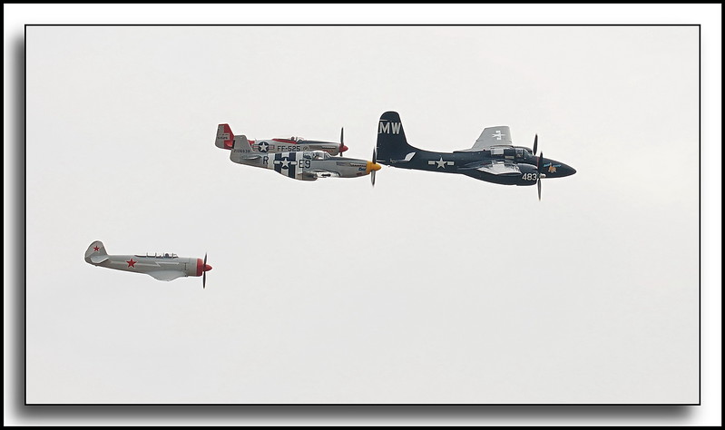 Warbird flight - Yak 11, P51B Mustang (foreground),  P51D Mustang (background), F7F Tigercat