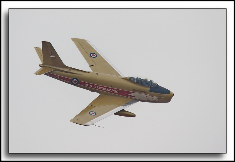 """Hawk One"" F-86 Sabre;  in the colours of the Golden Hawks.  The Golden Hawks were a Canadian aerobatic display team that flew between 1959 and 1964."