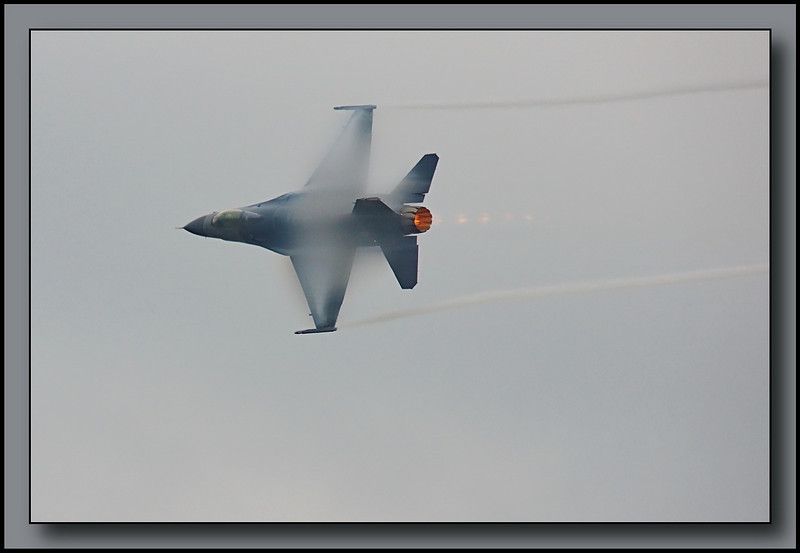 F-16C in high speed flyby pulling a few G's as it begins its' turn to clear the end of the airfield.