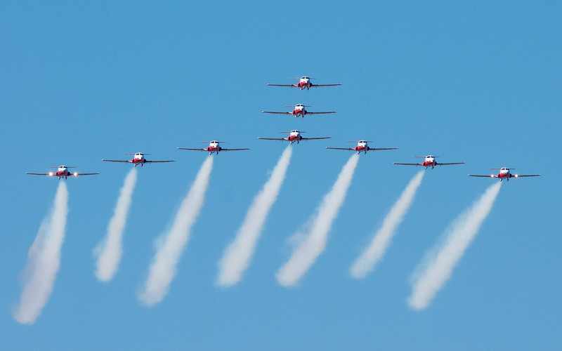 """CAF Snowbirds - """"smoke on"""" start of routine with a pass north to south from behind the crowd."""