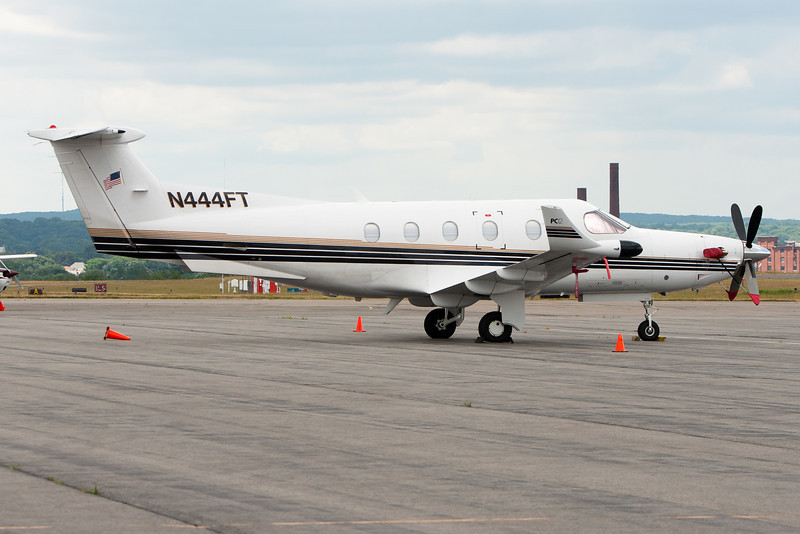 A Pilatus PC-12 sits on the ramp at Lawrence Municipal.