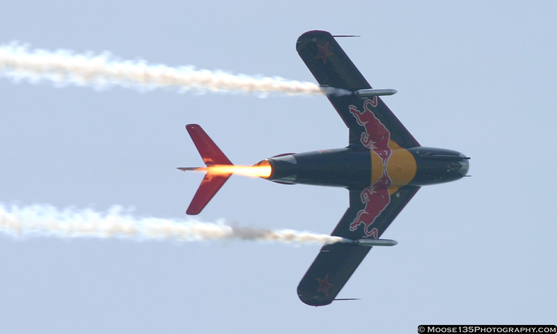 Red Bull's MiG-17F makes a fiery pass.