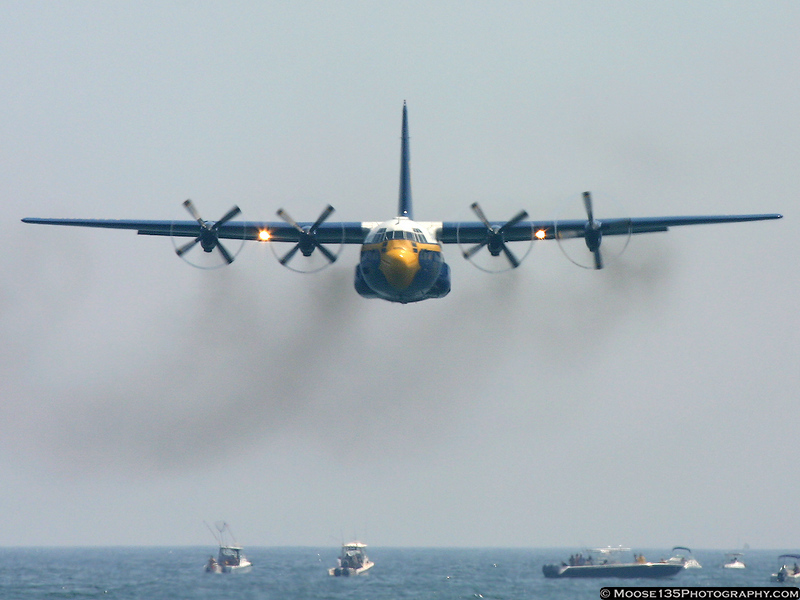 Fat Albert, the Blue Angels support aircraft, heading at the crowd to start the Blue Angels performance.