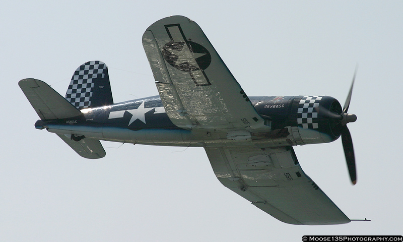 The Bent-Wing Bird - Navy F-4U Corsair thrills the crowd with a high-speed pass.