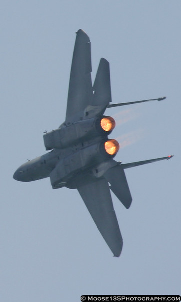 Afterburners blazing, this F-15 makes a high-G turn in front of the crowd.