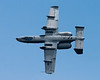 The A-10 Thunderbolt II (AKA Warthog) banks away, displaying its weapons carrying attachments.