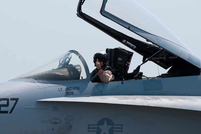 Giving a wave to the appreciative crowd is this F-18 pilot.