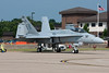 A Demo F-18 sitting on the ramp with its wingtips folded up.