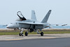 The F-18 Hornet taxis by, canopy up, to wave to the crowd.