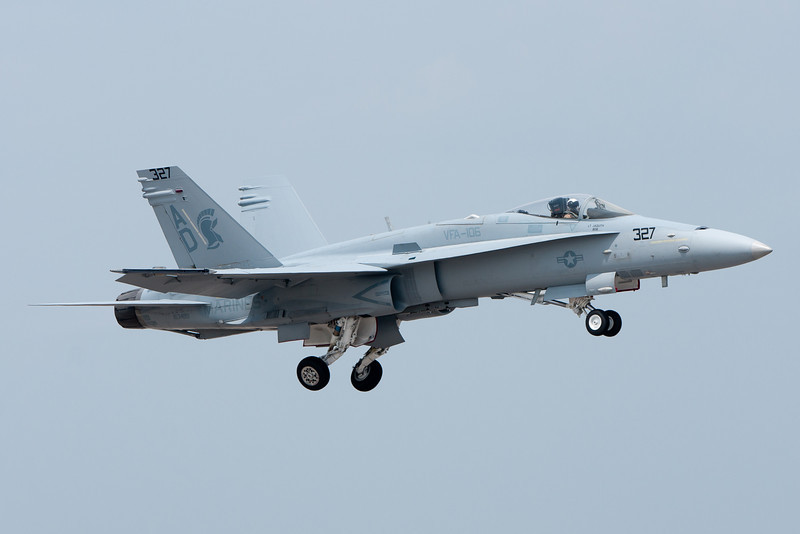 The F-18 demo takes off and retracts its gear.