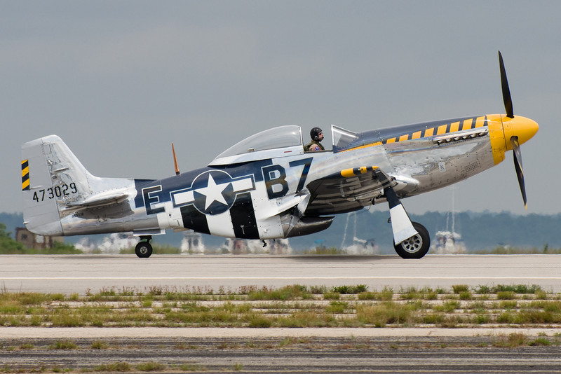 The P-51 touches down.