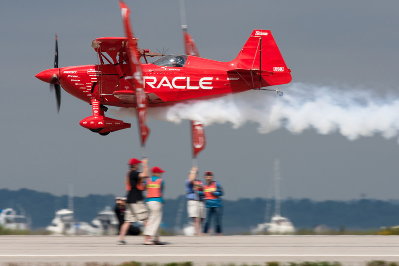 Sean D. Tucker splits the banners on a low runway pass.