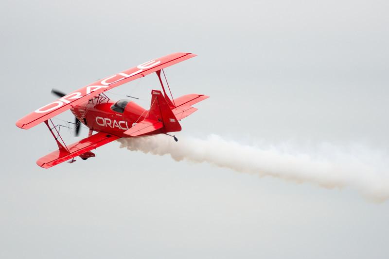 Sean D. Tucker flying away.