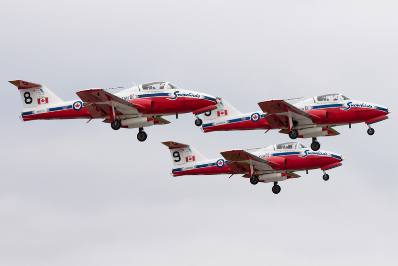 Three Snowbirds take off for their practice run.