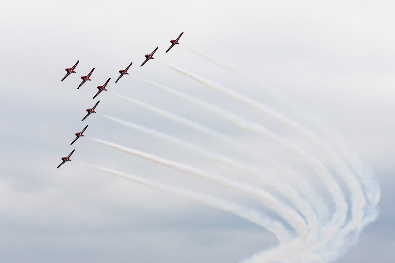 The Snowbirds fly by in an inverted Y formation.