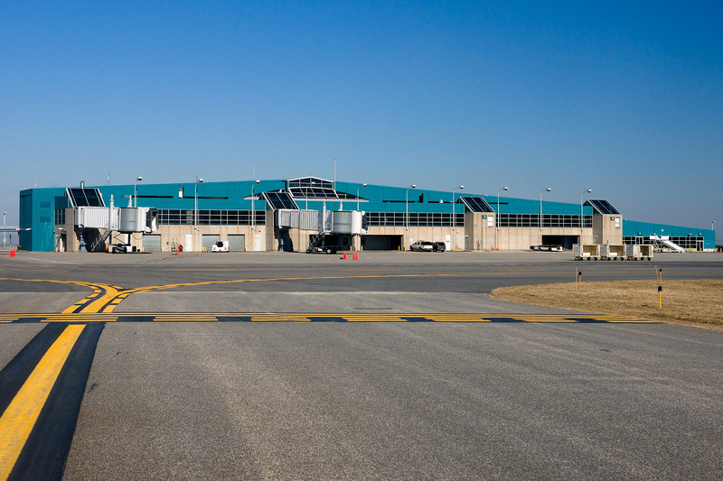Worcester Airport's terminal as seen from airside. Note two gates that lack jetways and two ground level gates. Starting left to right, Gates 1-2 with jetways, Gates 3-4 with none, gates 5-6 ground level.