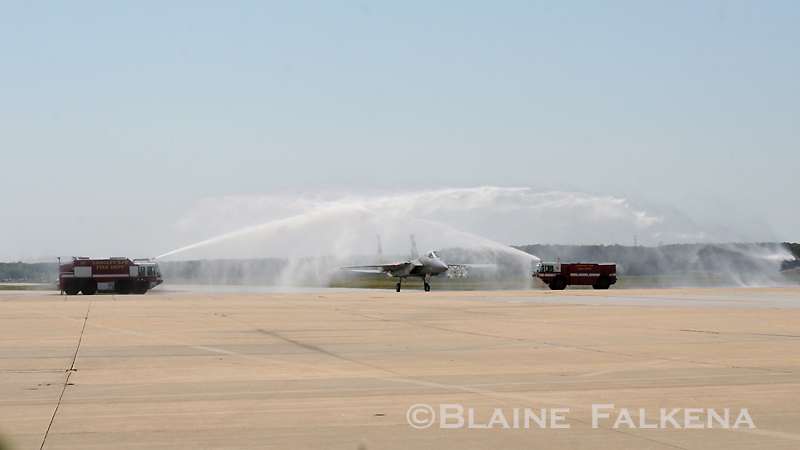 Fire crews at Langley Air Force Base douse an F-15C after it landed following its final flight as a single-aircraft demonstrator during Airpower Over Hampton Roads April 26th, 2009.