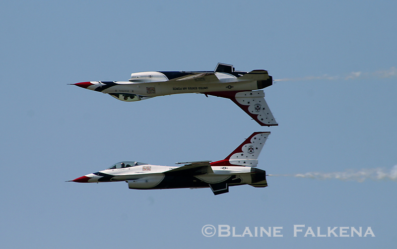 Two USAF Thunderbirds F-16 fighter jets fly over Langley Air Force Base during Airpower Over Hampton Roads April 26th, 2009. (BLAINE FALKENA)