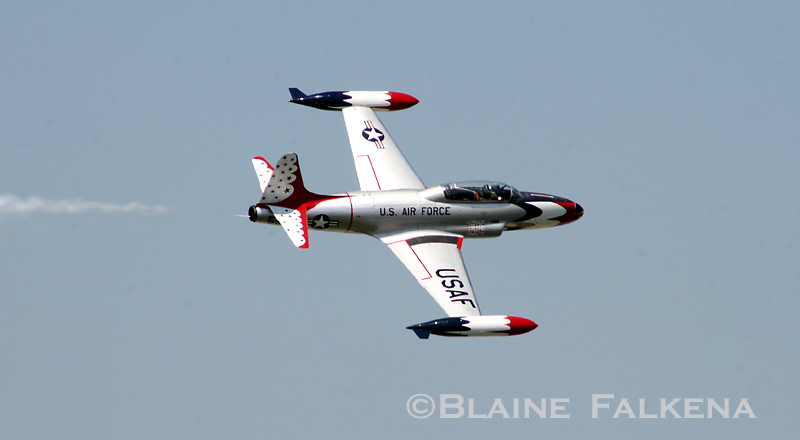 A T-33 painted in the USAF Thunderbirds paint scheme flies over Langley Air Force Base during Airpower Over Hampton Roads April 26th, 2009. (BLAINE FALKENA)