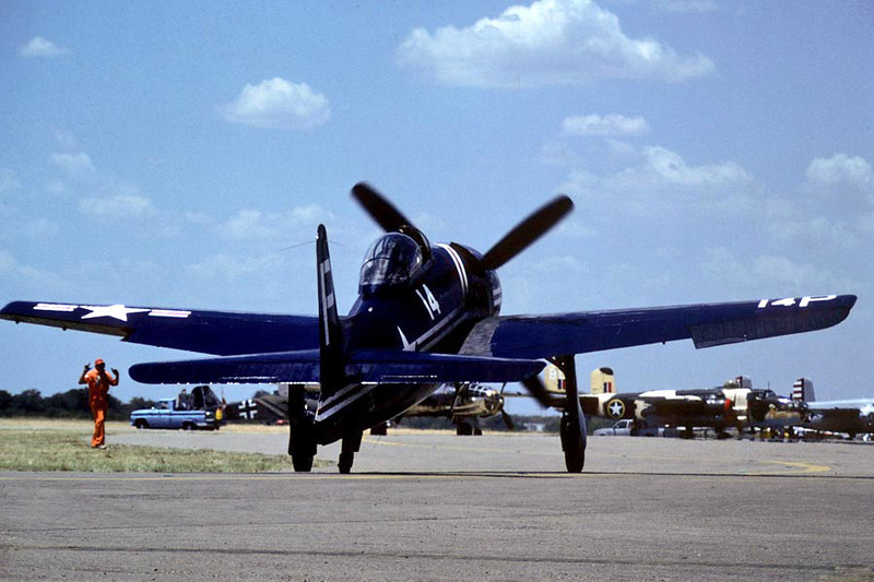 Grumman F8F-1 Bearcat [1945] N14HP (BuNo 90446)<br /> Confederate Air Force Airshow, Denton, Texas - July 1984<br /> <br /> On July 29, 1999, a Vought F4U-4 Corsair, N712RD, operated by a commercial pilot, was destroyed when it collided with a Grumman F8F-1 Bearcat, N14HP, which was positioned on the east edge of runway 18 at Wittman Regional Airport, Oshkosh, Wisconsin, approximately 1,400 feet from the departure end. The Bearcat was substantially damaged in the collision. At the time of the collision, the Bearcat was stationary on the runway with its engine at idle power. The Corsair was at full power on takeoff roll and struck the Bearcat from behind. After the collision, the Corsair cartwheeled and burst into flames, finally coming to rest inverted. The pilot of the Corsair was seriously injured. The pilot of the Bearcat reported no injuries. The right wing of N14HP was severed outboard of the landing gear, and the left wing was also severely damaged. The word is that it will need a total rebuild.
