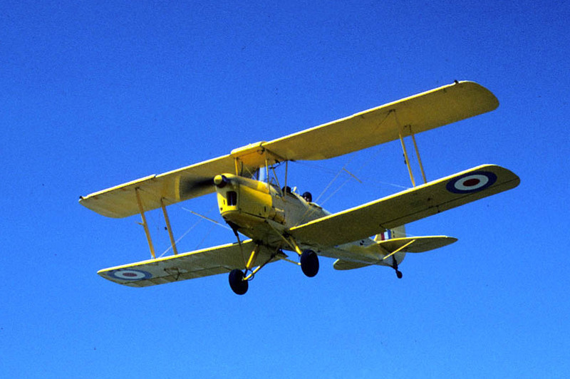 de Havilland D.H.82 Tiger Moth [1934]<br /> Santa Paula Airport, Santa Paula, California - May 1975<br /> <br /> Here's my buddy Don and his friend on final approach. The really nice thing about photographing airplanes at Santa Paula Airport was the great vantage point at the very end of the runway -- that and the place was usually swarming with antique airplanes, especially on the weekends.