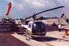 Bell 47J Ranger<br /> Santa Paula Airport, Santa Paula, California - early 1970s<br /> <br /> This version of the Bell 47 design mated the cockpit, engine, and tail boom into a clean, enclosed housing, giving it a very sleek appearance which carries on today. The Bell 47J is a fairly historic helicopter in that two military versions -- designated UH-13J -- were purchased from Bell and specially modified for use as the first presidential helicopters. President Dwight D. Eisenhower became the first U.S. president to fly in a helicopter when he took off in a UH-13J from the White House lawn in 1957.